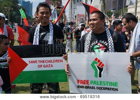 Kuala Lumpur, Malaysia - August, 2: People protest against Gaza strip bombing  during the pro-Palestine rally in Kuala Lumpur, August 2, 2014.