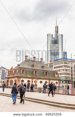 People walking in the streets in front of the Hauptwache building in Frankfurt
