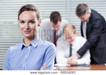 Businesswoman And Her Co-workers
