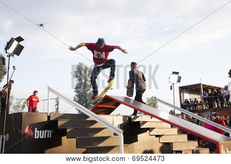 BONTIDA - JUNE 21: Unidentified skateboarder doing a slide trick during the Skateboard Competition at Electric Castle Festival on June 21, 2014 in the Banffy castle in Bontida, Romania