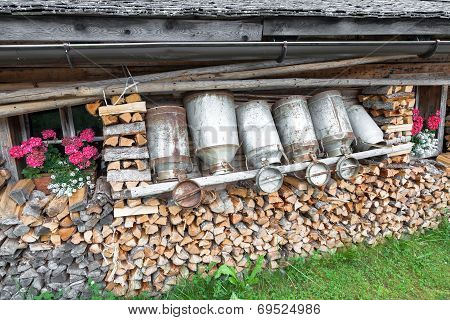old milk cans and firewood in a alpine hut