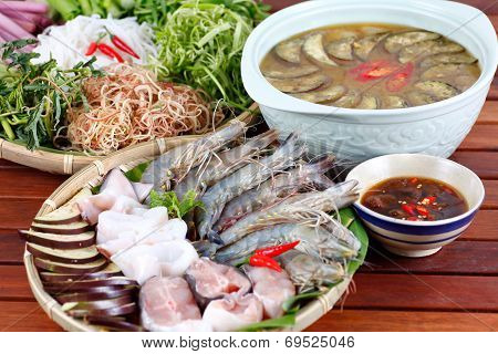 Vietnamese Traditional Food: hotpot with seafood ( shrimp, squid, fish)  and vegetable with special