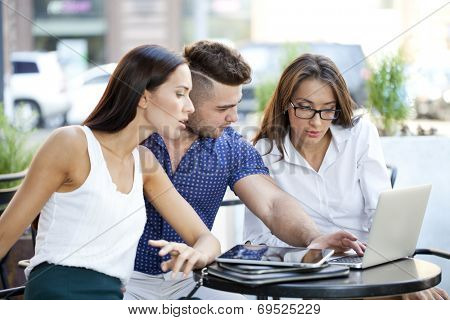 Business team working at laptop in a office outdoor