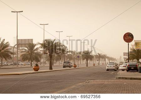 Rahima, Saudi Arabia - May 11, 2014: Street View With Cars And Palms, Dust Storm In Saudi Arabia