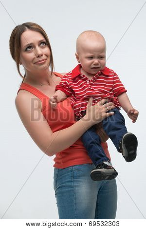 Cute toddler boy is naughty on mom??s hands