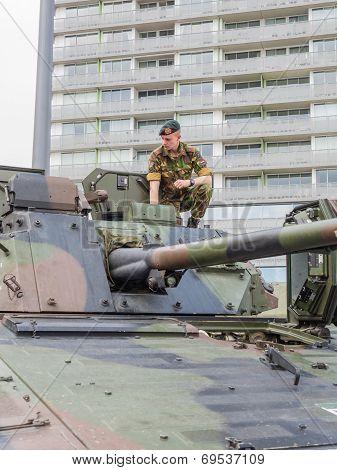 Soldier Sitting On Tank