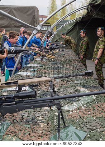 Kids Trying Rifles On Army Day