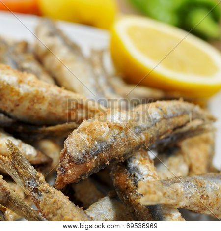closeup of a plate with some spanish boquerones fritos, fried anchovies typical in Spain, served as tapas