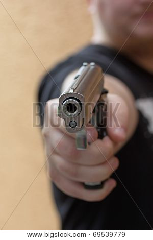 Gun Pointed Toward The Camera