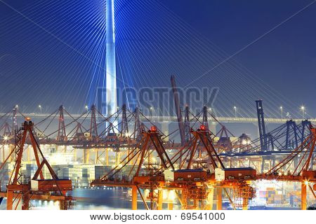 Port warehouse with containers and industrial cargoes at night