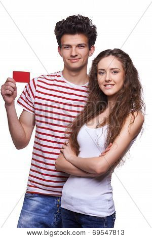 Young casual couple showing credit card