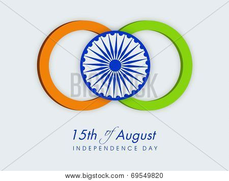 Stylish circles in saffron and green colors with Asoka Wheel on grey background for 15th of August, Indian Independence Day celebrations.