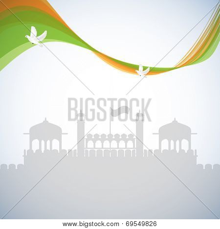 National tricolors wave with flying pigeons on red fort silhouetted grey background for 15th of August, Indian Independence Day celebrations.