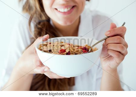 Young Woman In Underwear Eating Cereals. Isolated On White.