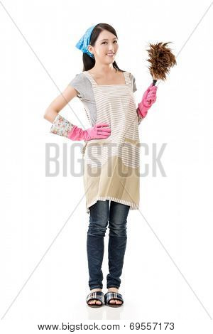 Portrait of Asian housewife using feather duster, full length portrait on white background.