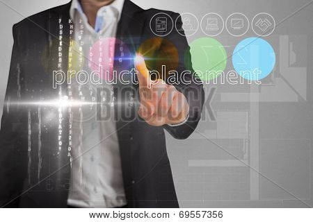 Businessman touching the words product placement on interface against grey vignette