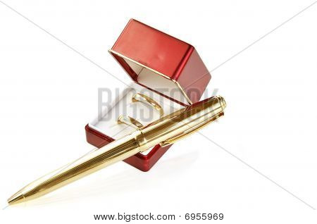 Wedding Rings In Red Box And Golden Pen.