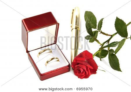 Wedding Rings, Small Red Rose And Pen.