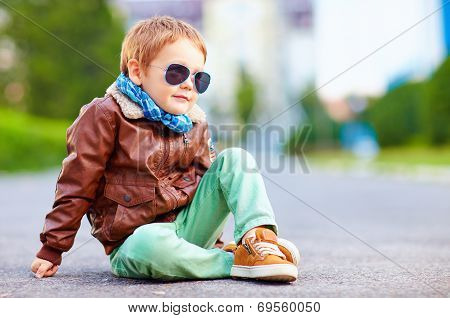 Cute Stylish Boy In Leather Jacket Sitting On The Road
