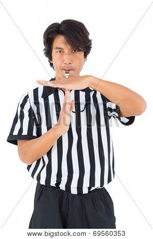 Stern referee showing time out sign on white background