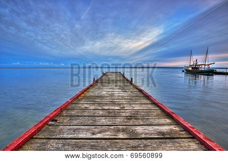 Wooden haven in the bay of Puck and boat