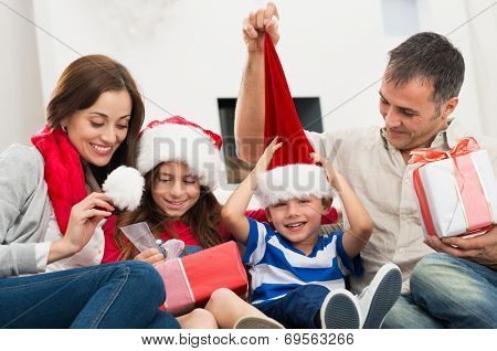 Happy Family Holding Christmas Gift