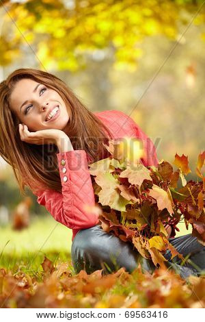 Fall woman- Autumn portrait of happy lovely and beautiful  young woman in forest in fall colors.