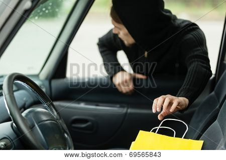 Thief Stealing Shopping Bag From The Car