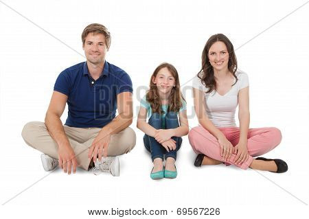 Happy Family Sitting Over White Background
