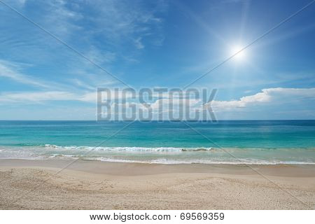 Sandy beach and sun in blue sky
