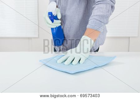 Woman's Hand Wiping Table With Rag