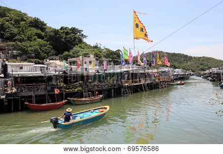 canal and stilt houses of Tai O in Hong Kong