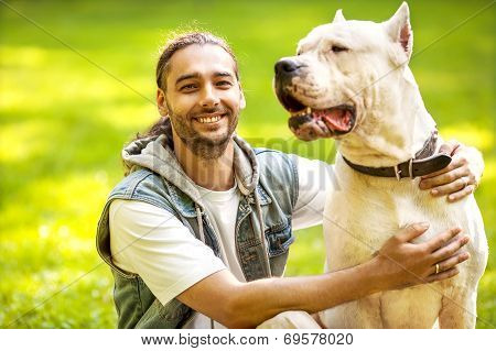 Man And Dog In The Park.