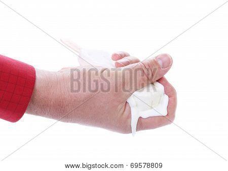 Hand holds melting ice cream.