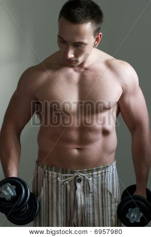 Muscular guy workout