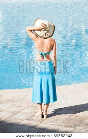 Happy Woman Standing At Poolside