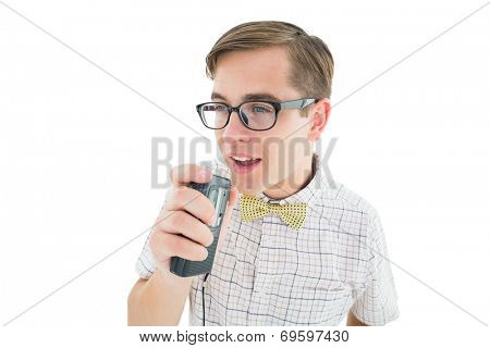 Geeky hipster speaking into dictaphone on white background