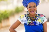 stock photo of zulu  - happy young african zulu woman laughing  - JPG