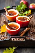 image of cider apples  - Apple cider with cinnamon sticks and anise star in apple cups - JPG