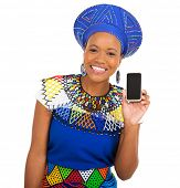 picture of traditional attire  - cheerful african girl in traditional clothes showing smart phone - JPG