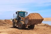 picture of oversize load  - On photo Yellow Bulldozer at Construction Desert Chanel  - JPG