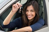 stock photo of key  - Young Happy Woman Showing The Key Of New Car - JPG