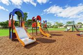image of suburban city  - Lush colourful playground in suburban australian park - JPG