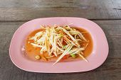 foto of green papaya salad  - Green papaya salad Somtum Thai food on table - JPG
