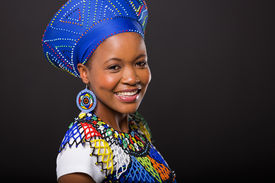 image of zulu  - smiling zulu woman in traditional clothes looking at the camera on black background - JPG