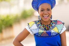 stock photo of zulu  - happy young african zulu woman laughing  - JPG