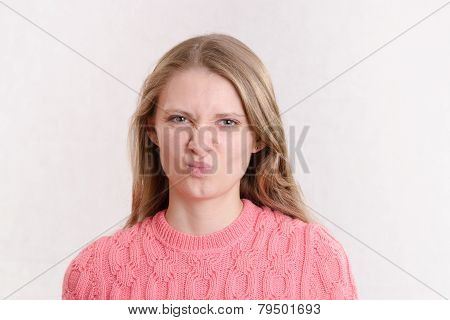Young Girl Looks In Disgust Frame
