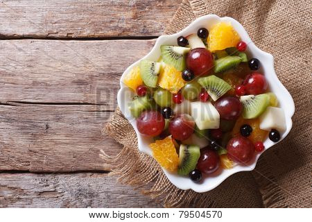 Fruit Salad In White Plate Horizontal Top View, Rustic