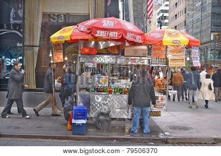 A hot dog stand vendor