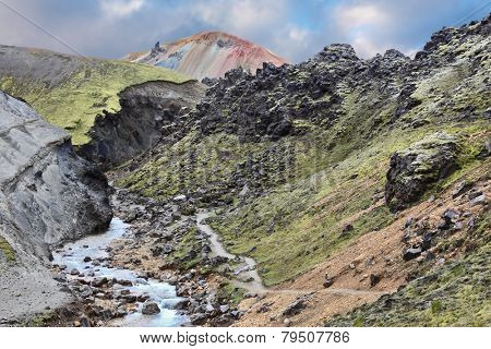 Creek at the bottom of a picturesque gorge. National Park Landmannalaugar in Iceland